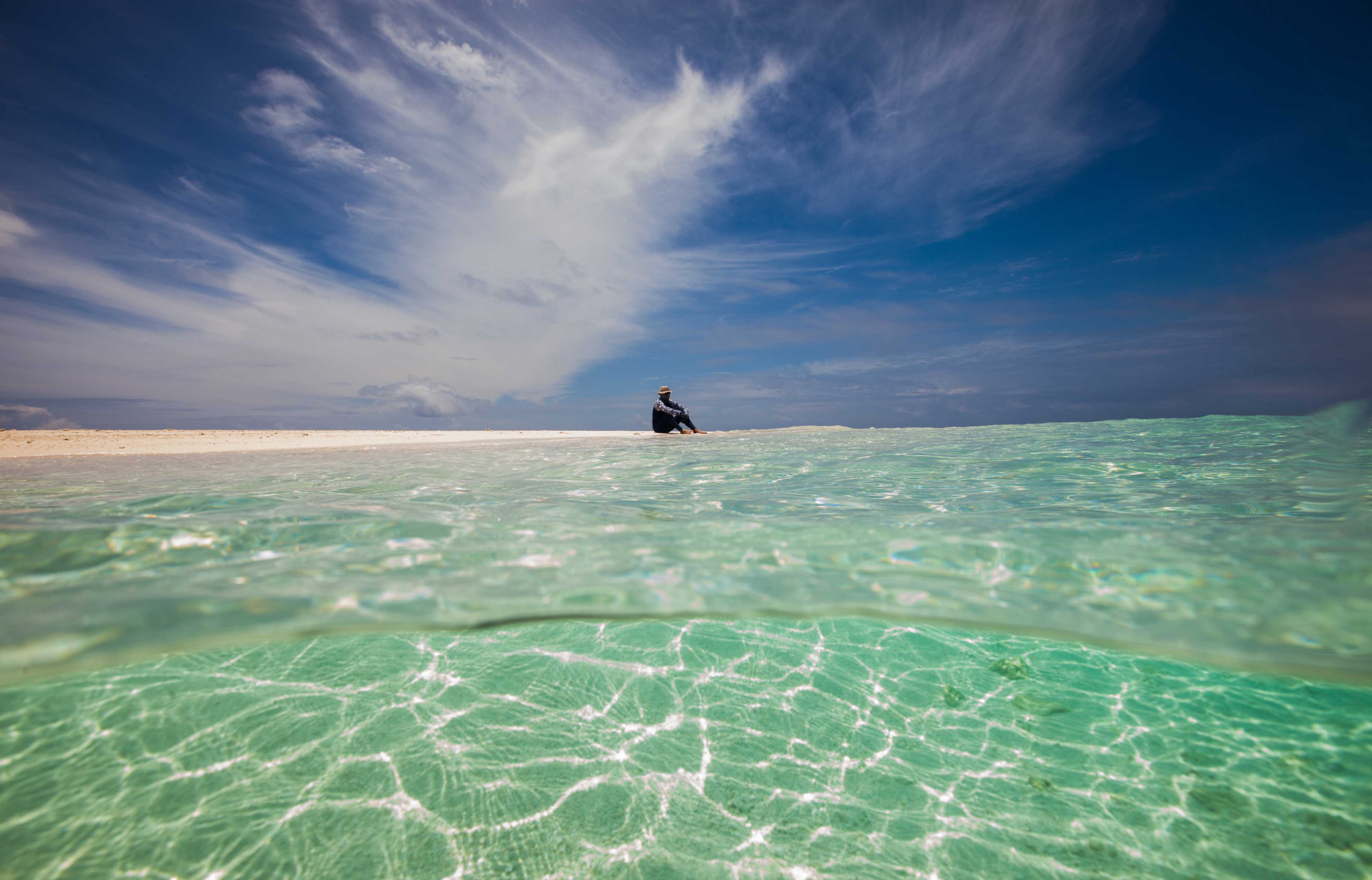 man on sand cay