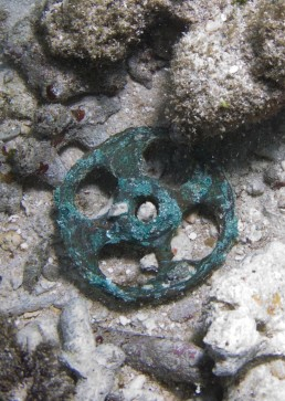Copper alloy pulley sheave found on site.