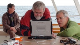 Maritime archaeologists Paul Hundley and Nigel Erskine review survey data.
