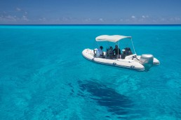 Expedition tender floating on crystal clear water in the lagoon.