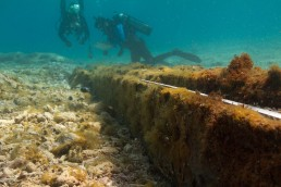 Divers record wooden keel section found in the lagoon.