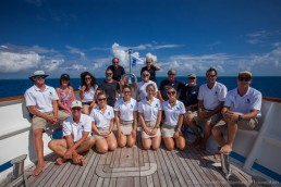 The expedition team and crew on board Silentworld at Kenn Reefs. Image: Julia Sumerling for Silentworld Foundation, 2017.