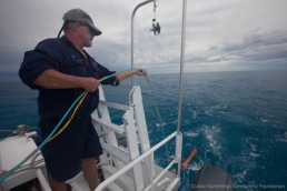 Lee Graham launches the magnetometer fish off the back of Maggie III. Image: Julia Sumerling for Silentworld Foundation, 2017.