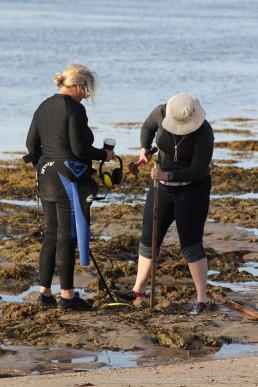 South Australian Maritime Museum Senior Curator, Lindl Lawton and Flinders Uni masters student Adeena Fowke, set up a datum point on the shore. Copyright: Irini Malliaros/Silentworld Foundation