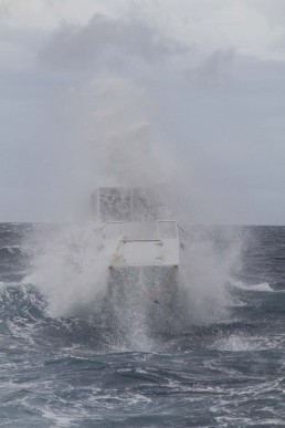 Boat smashing through the waves during the Comet and Hydrabad expedition