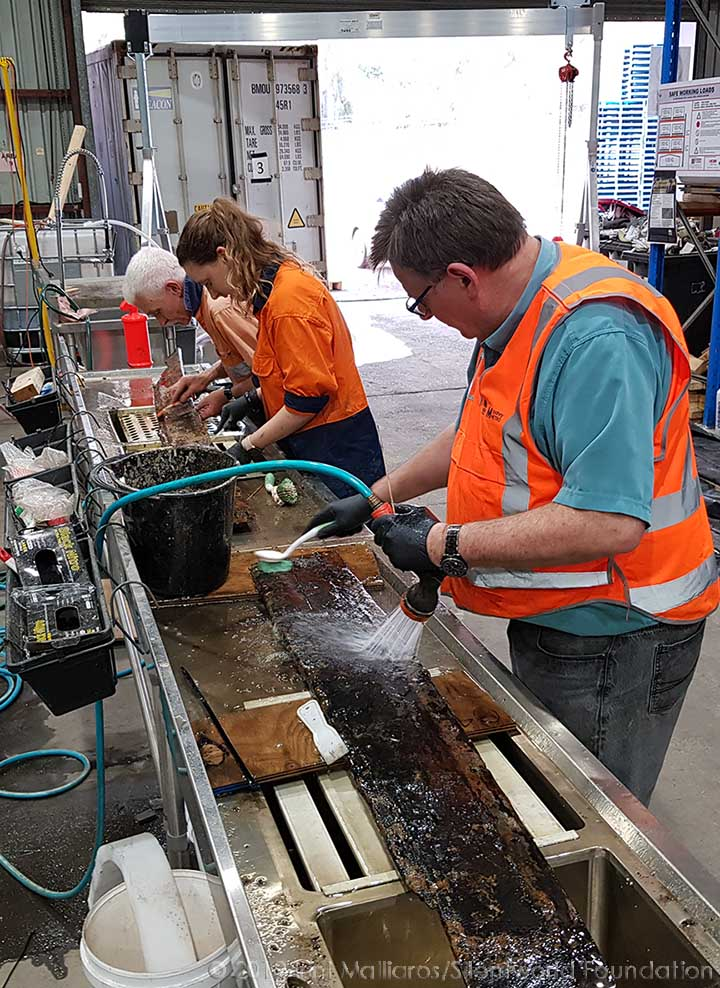 Cleaning timbers. Image: Irini Malliaros/ Silentworld Foundation for Sydney Metro, used with permission.